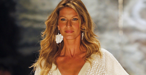 Brazilian top model Gisele Bundchen presents a creation from Colcci's Summer 2015 collection at Sao Paulo Fashion Week in Sao Paulo